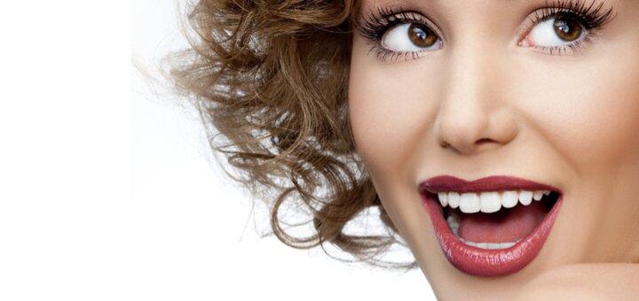 Скидка до 82% на чистку зубов и установку украшения на зуб в стоматологии «Holliwood Smile»